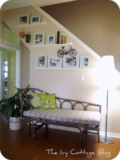 Vintage Chaise Lounge Re-Do w/ photo gallery wall.   Love the echoing of the green in the adjoining room!