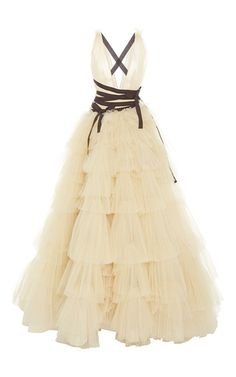 This **Carolina Herrera** ball gown features a deep v neckline, crossed back straps and ruched tiered floor length skirt.