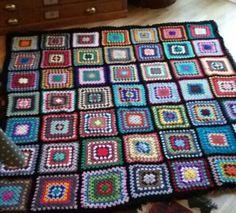 Granny square crochet blanket. Random retro colours