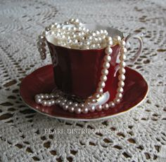 #red teacup with #pearls and #lace