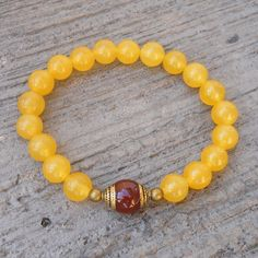 Yellow jade gemstone mala bracelet with Tibetan capped carnelian guru bead by #lovepray #jewelry