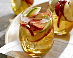 White Sangria: Bursting with sparkling flavor, this clean version of sangría is unique in its use of ice cubes made from apple juice. For parties, this can be served in a large, transparent punch bowl next to a transparent bowl containing traditional red sangria. This pairing provides a beautiful contrast, provided they are not immediately consumed by eager guests, as is often the case.