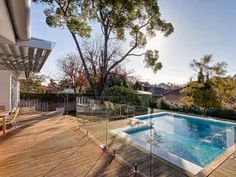 In-ground pool design using timber with decking & fountain - Pool photo 1523324