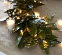burlap, magnolia leaves, candles, and string lights.  Simple Christmas table