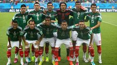 Mexico players pose for a team photo against Cameroon.