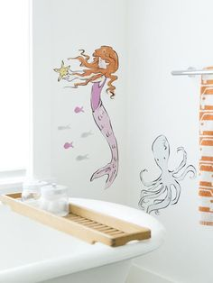 The perfect wall decals for your on-land home. 20 Gifts Every Wannabe Mermaid Needs To Ask For This Year Wall Stickers, Wall Decals, Ocean Bedroom, Girls Bedroom, Mermaid Wallpapers, Mermaid Ornament, Pink Fish, Modern Home Furniture, Little Girl Rooms