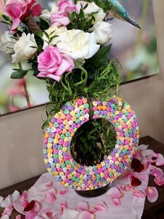 Make a #wreath for just about every season and #holiday! To celebrate #ValentineDay, we decorated a foam circle by covering it with colorful #heart #candy! So easy to make and just change the candy to match any holiday!