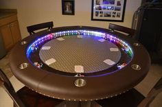 An amazing poker table that you and the boys can sit around have some drinks and lose all your money.