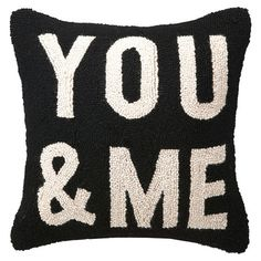 Hand-hooked wool pillow with block lettering.     Product: PillowConstruction Material: Wool cover and polyester fill