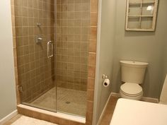 Simple tile with outside wall. Could spiff it up with a band of small tiles around the top, but not so likely to go out of style as fast as other tile jobs I've seen. Bathroom Shower Remodel Advise-tile-shower.jpg