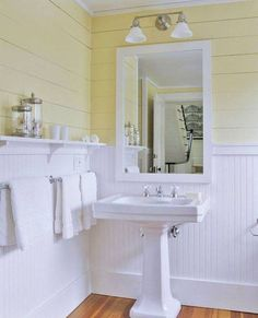Bathroom , Charming Beadboard Wainscoting In Bathroom : Beadboard Wainscoting In Bathroom With Yellow Plank Walls And Shelf And Towel Bars And Pedestal Sink And Mirror And Vanity Sconce
