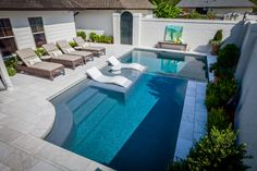 Create the perfect outdoor scene with Ledge Lounger in-pool furniture. Designed…