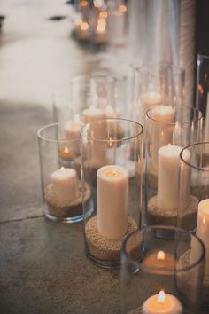 I like these candles as decor , but with pearls instead of sand or grain inside .