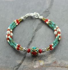 These cool bracelets are affordable and simply beautiful. 3 strands of turquoise and coral beads connect to a vintage turquoise and coral Tibetan bead Center be