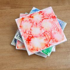 DIY These Dreamy Watercolor Tile Coasters: Need a quick gift or a pop of color to liven up your living room?