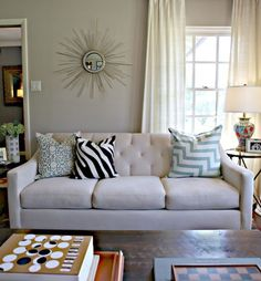 Chic living room design with soft greige walls paint color. Love the chevron cusion on the mofern sofa.