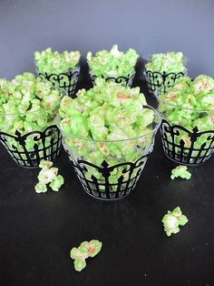Purple Chocolat Home: Green Slimed Popcorn Black lattice cupcake holders from Wilton; small plastic cups inserted; add green popcorn.