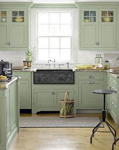 super cute cottage kitchen with minty green paint....neat farm sink with etching??
