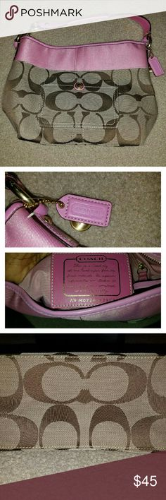 Coach purse Signature print with pink accent. Includes coach tag. No dust bag. Very good condition except for ink markings on the inside. Picture above. Coach Bags