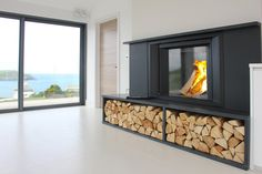 This Stuv Micro Mega looks amazing in this monotone room ina home in Polzeath. The spectacular view really helps too! Installed by Kernow Fires in Cornwall. Stove Installation, House, Home, Fireplace Surrounds, New Homes, Fireplace Shelves, Cafe Design, Modern Fireplace, Interior Design
