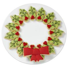 Shimmering Christmas Cookie Wreath - What a stunning centerpiece this cookie wreath will make on your holiday dessert table! The leaves and bow get their shape from our Wreath Cookie Pan.