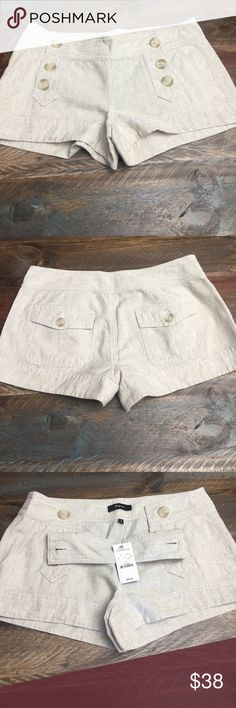 Express shorts Brand new with tags adorable cream/beige shorts. 2 back button pockets, 2 side front pockets. 3 buttons which open down each side of front.  Really adorable size 4 from Express Express Shorts