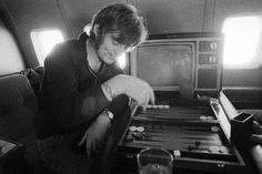 """John Paul Jones of Led Zeppelin aboard the bands private jet, """"The Starship"""" Rock N Roll, Rock And Roll Bands, Great Bands, Cool Bands, Robert Plant Led Zeppelin, Houses Of The Holy, The Quiet Ones, John Paul Jones, John Bonham"""