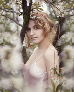 Spring photoshoot, soft pink colors, blooming tree