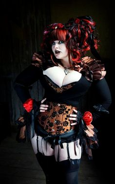 Love this: http://www.etsy.com/listing/79352902/steampunk-diva-burlesque-bustle-skirt?ref=sr_gallery_25=_search_submit=_search_query=plus+size+clothing+goth_order=most_relevant_ship_to=US_view_type=gallery_search_type=handmade_facet=handmade