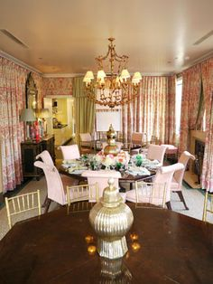 Mario Buatta ~ Multiple tables make the dining room less formal. When necessary the octagons can be combined into one large table which seats up to 22 people.