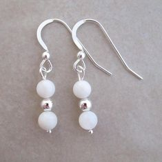 Dreamy mother of pearl earrings. These pretties are accented in sterling silver.