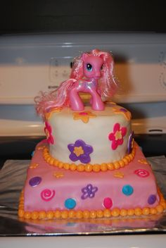 A tiered My Little Pony cake I did for a cousins little girl.  MMF and melted chocolate shapes. The topper is an actual pony (not edible!)