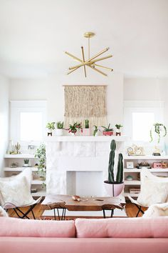 Plants on the mantle & blush pink sofa