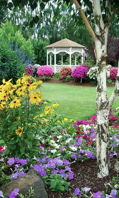 Lovely lawn, flowering shrubs and perennials and gazebo.  Harry P. Leu Gardens in Orlando, Florida, photo: Renaude Hatsedakis on Examiner In Birmingham, AL get awesome #sprinkler and #landscape lighting service from www.BlueSkyRain.com.