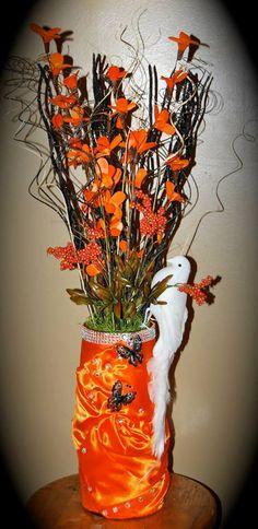 Beautiful orange vase with white dove design by me.
