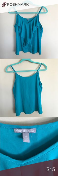 ❣️LOWERED PRICE❣️ Turquoise tank top. Turquoise, spaghetti strap, ruffled tank top. Has adjustable straps. LIKE NEW! Only worn once, because I didn't like the way it looked on me. 100% polyester. Charlotte Russe Tops Tank Tops