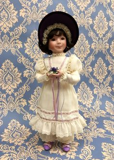 """""""Sweet little Violette"""". Designed by artist Dianna Effner and crafted under the hallmark of The Ashton-Drake Galleries."""