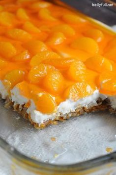 Mandarin Orange Pretzel Dessert - This classic dessert features a crunchy pretzel crust, a creamy center, and silky top with mandarin oranges and orange flavored gelatin. Perfect for a summer luncheon!