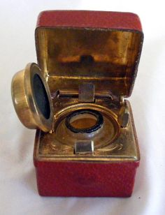 leather and brass travelling ink well