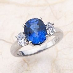Blue Sapphire Engagement Ring-14k white gold engagement with 3.00ctw -10X8- lab created Sapphire w/ side stone .60ctw of G SI2 oval diamonds