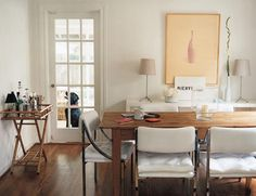 wood table, white chairs