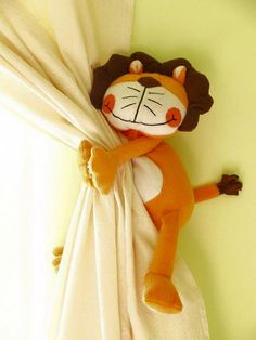 Use a stuffed animal for a tie-back for curtains. Sew a small plastic ring onto the back of the stuffed animal. Then use a 3M adhesive wall hook to attach the stuffed animal. Easy and so cute!