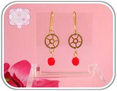 Orecchini con piccolre ruote dorate e mezzo cristallo rosso