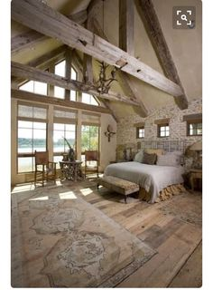 Master BR. Love the smaller square windows above the bed. Vaulted ceilings and beams. Walkout to a private deck