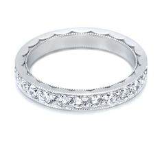 Platinum and pave eternity band featuring a hand-engraved, crescent design.