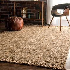 Accent your bohemian decor with a touch of natural texture with this handmade chunky-loop jute rug from nuLoom. The braided thick-weave and large pile height will have a soothing effect in your bedroom or living room.
