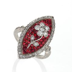 An Edwardian platinum and 18 karat gold ring with rubies and diamonds