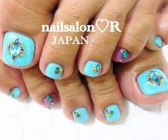 Pretty turquoise pedicure with jewels