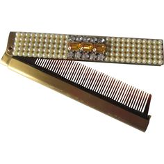Compact Jeweled Folding Comb Vintage 1950s Faux Pearl Amber Rhinestone Vanity http://www.rubylane.com/item/676693-CLL197/Compact-Jeweled-Folding-Comb-Vintage-1950s