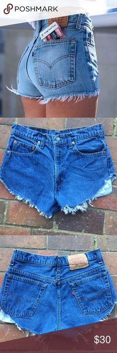 Levi's Cut Off Vintage Shorts Classic cut off & frayed Levi's Denim Shorts 🔹perfect medium Blue wash🔹 | Approx Measurements ✨ Waist: 13.5 in (25-26) ✨ Rise: 11 in |  SO flattering for your rear-end-perfect summertime shorts Levi's Shorts Jean Shorts